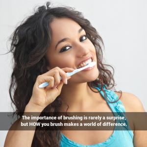 A beautiful young woman brushing her teeth