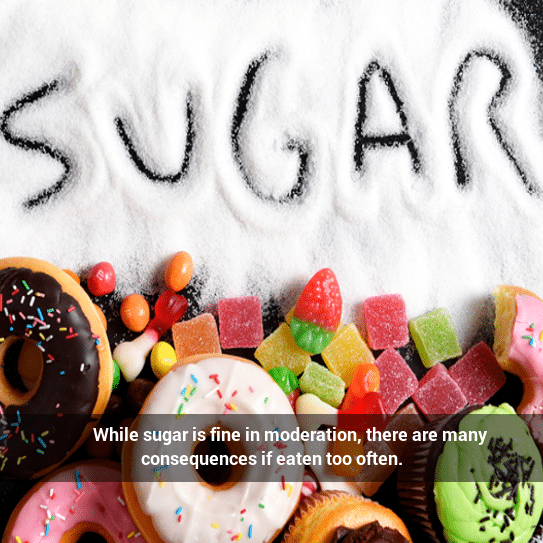 Sugar spelled out in sugar over candy and donuts