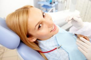 A woman who is having sedation to help ease her nervousness at the dentist