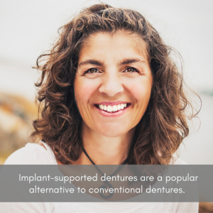 Woman smiling with perfect looking dentures.