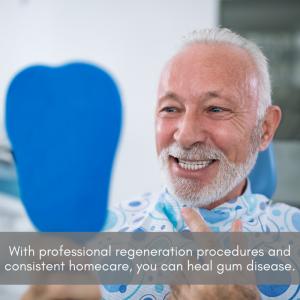 Senior man looking in the mirror at his teeth at a dental office