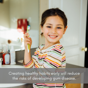 Young girl preventing gum disease by brushing her teeth.
