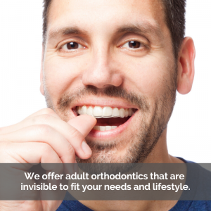 Man with Invisalign aligners smiling.