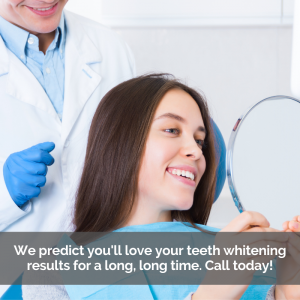 A girl gets teeth whitening treatment. She looks at her smile in a mirror.