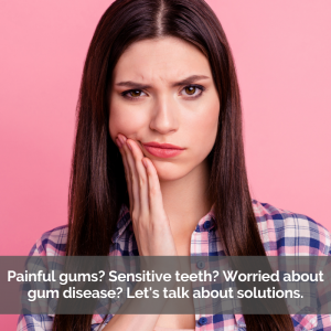 A women worries about gum disease while holding her cheek in pain.