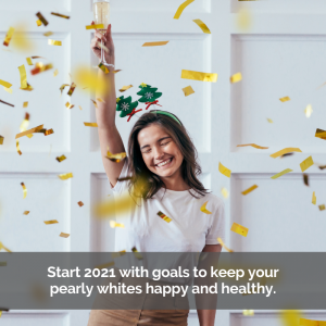 Keep good dental health in 2021. Woman celebrates with wine and confetti.