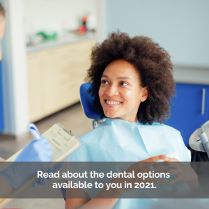 Ethnic woman sitting in a dental chair smiling.