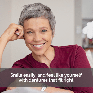A women smiling with perfect dentures